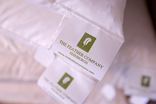 The Feather Company label on a cushion